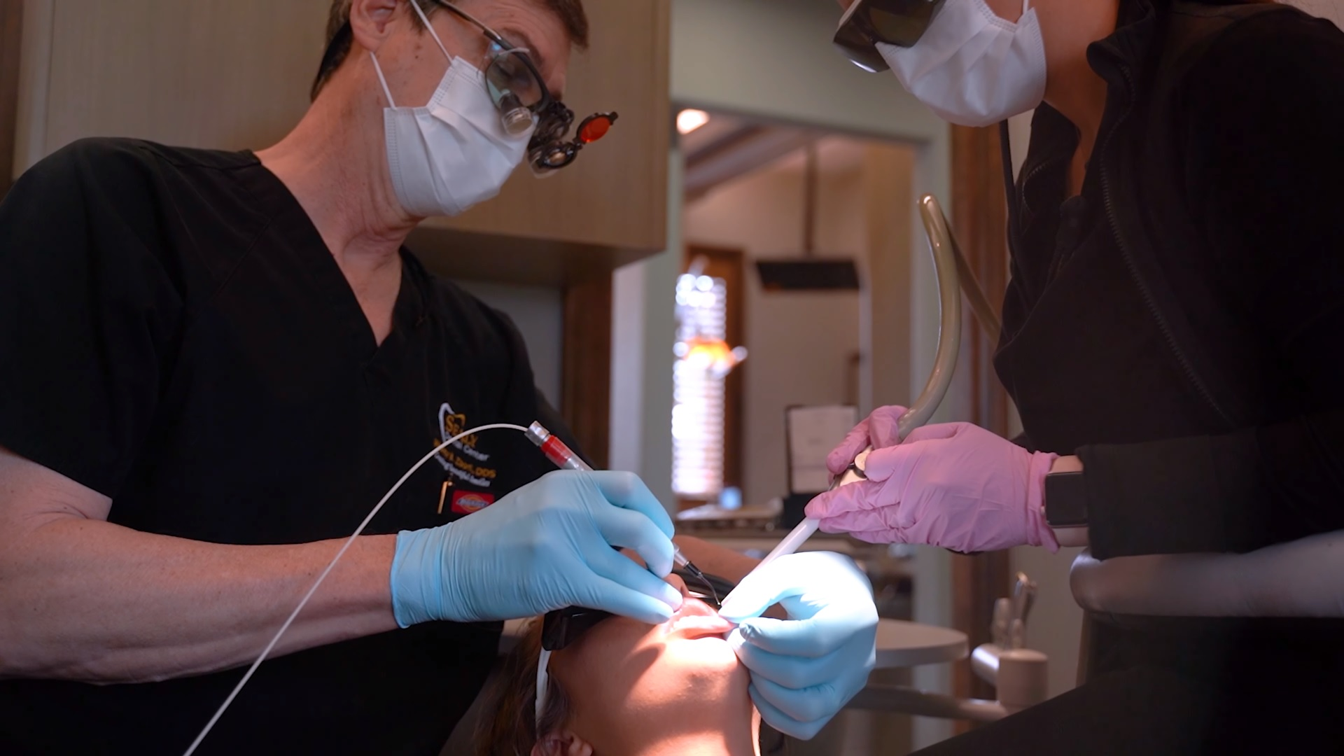 Dr Wesley Zboril performing endodontic treatment at Sealy Dental Center